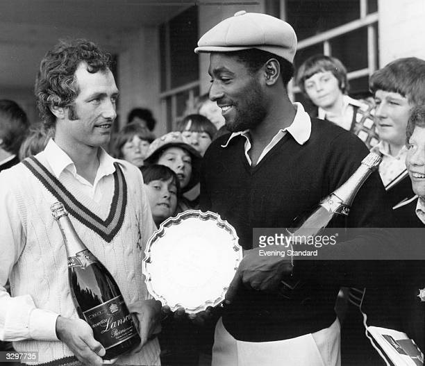 Viv Richards is presented with the Evening Standard's Cricketer of the Month award which includes a magnum of champagne