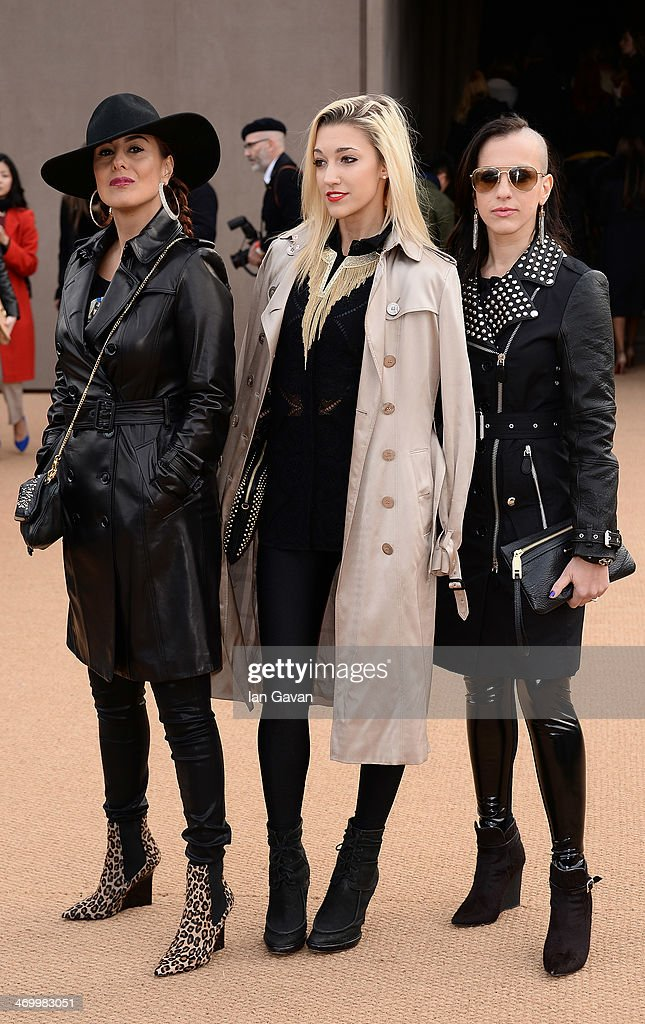 3rdeyeblind (L-R) Donna Grantis, Ida Nielsen and Hannah Welton arrive at Burberry Womenswear Autumn/Winter 2014 at Kensington Gardens on February 17, 2014 in London, England.