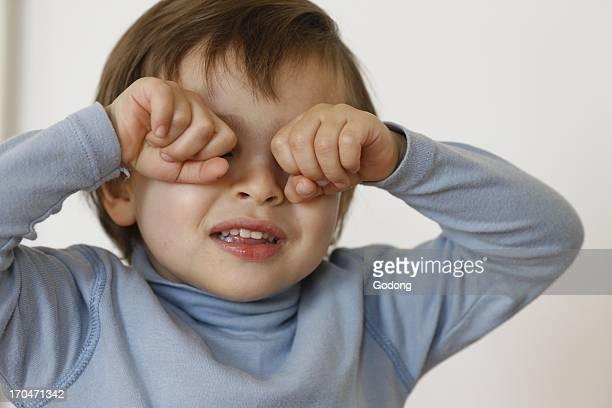 3yearold boy rubbing his eyes France