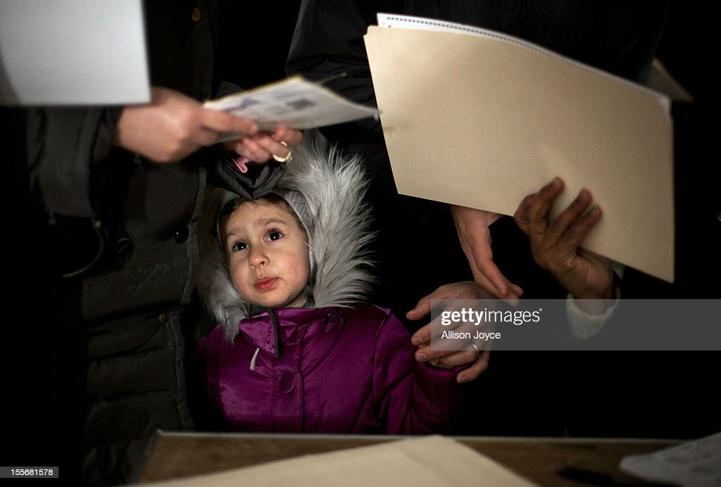 3-year-old Fiana waits for her parents to vote in the presidential elections in a tent in Midland Beach November 6, 2012 in the Staten Island borough of New York City. As Staten Island continues to recover from Superstorm Sandy, a few polling stations have been relocated due to power outages or ongoing use as an evacuation center.