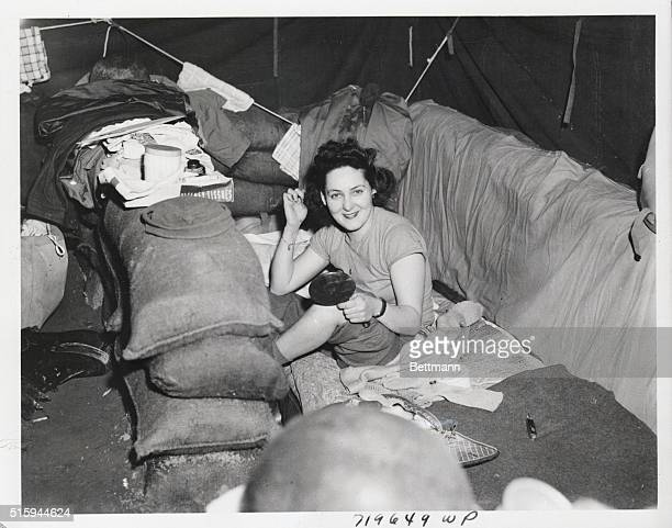 4/10/1944Anzio Italy Seated on her bed which is surrounded by sand bags for protectiion against enemy bombs and shells US Army nurse Lt Margaret...