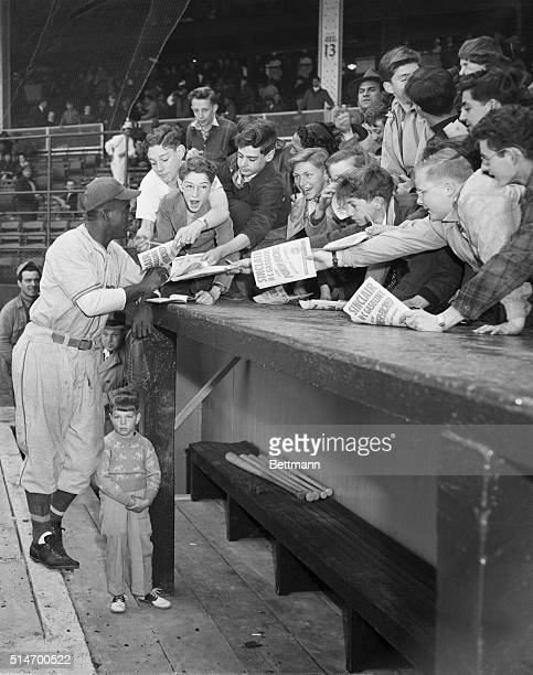 4/10/1947New York NY Jackie Robinson gets a big hand from young Dodger rooters who arrived early for the exhibition game between the Dodgers and...
