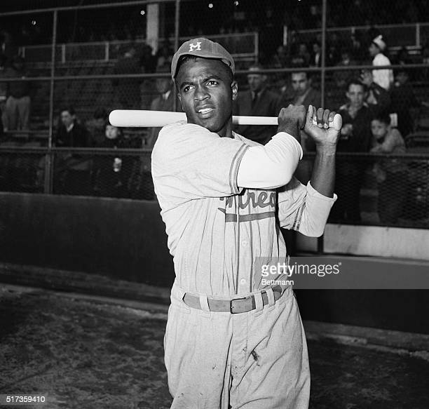4/10/1947New York NYJackie Robinson first Negro to be signed up by a Major League baseball team is shown in postswing position in front of the stands...
