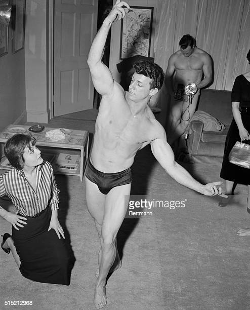4/10/1954New York NYMiss Novella Parigini is shown looking over the winner of a 'Typical American Male' contestDon Armandwhile in the background a...
