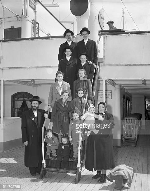 4/11/1949New York NY Rabbi User Weinberger his wife Fedora and their 12 children ranging in age from 7 months to 16 years arrive in New York aboard...