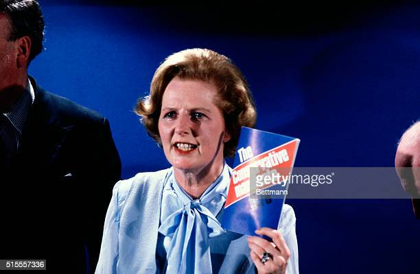4/11/79London England Mrs Margaret Thatcher holding up her party's manifesto when she held the Conservative Party's first press conference of their...