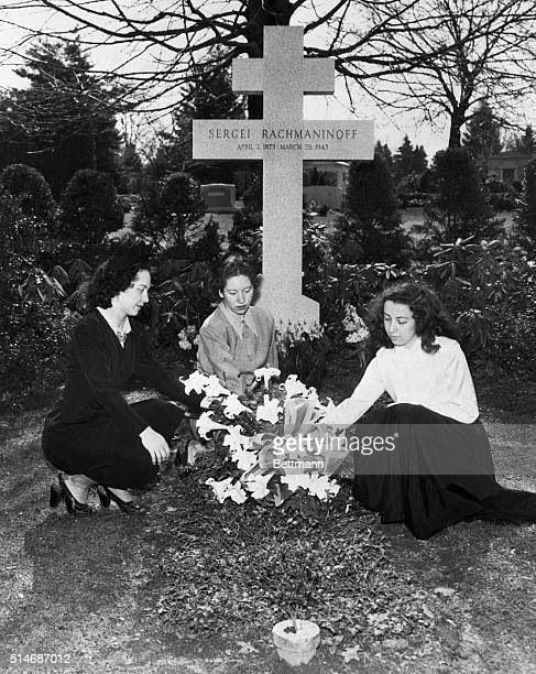 Marking the 75th anniversary of the birth of Sergei Rachmaninoff three young pianists place flowers on his grave in Kenisco Cemetery The great...