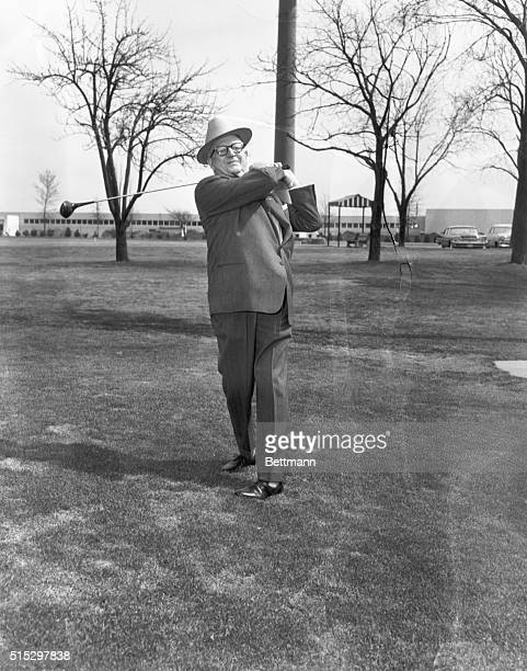 4/1/1958Niles IL Golf promoter George May takes a practice drive on the 18th hole at the Tam O'Shanter Country Club after announcing that he had...