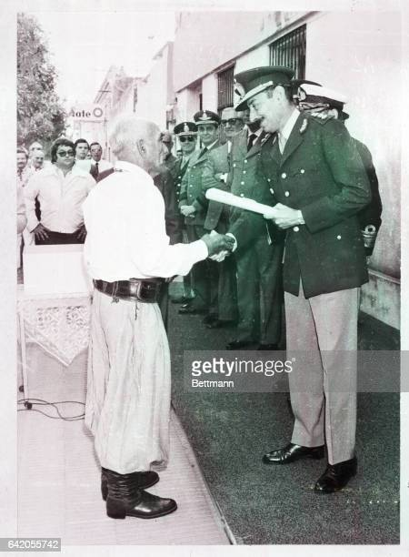 4/15/1977Reconquista ArgentinaGen Jorge Videla who has held office as President of Argentina for a little over a year hands a deed to a new landowner...