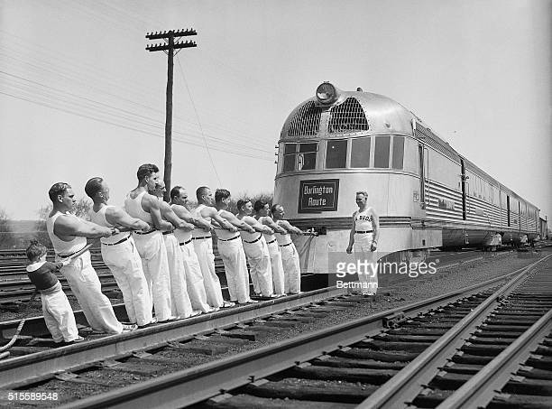 4/17/1934Philadelphia PA The lightness of the dieselpowered streamlined train 'Zephyr' of the Burlington Road is tested using man power supplied by...