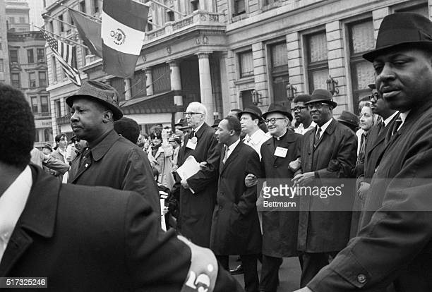 4/17/1967New York NY Walking arminarm during the April 15 antiVietnam demonstration here are From Left Dr Benjamin Spock Martin Luther King Monsignor...