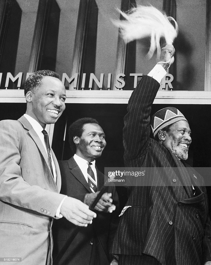 Nairobi, Kenya- Prime Minister <a gi-track='captionPersonalityLinkClicked' href=/galleries/search?phrase=Jomo+Kenyatta&family=editorial&specificpeople=211508 ng-click='$event.stopPropagation()'>Jomo Kenyatta</a> (R) of Kenya waves his plumed symbol vigorously to a crowd before entering the East African Heads of Government Conference held in Nairobi. Sharing the delight of the cheering reception are Dr. Nyerere (L) of Tanganyika and Dr. Obote (C) of Uganda.