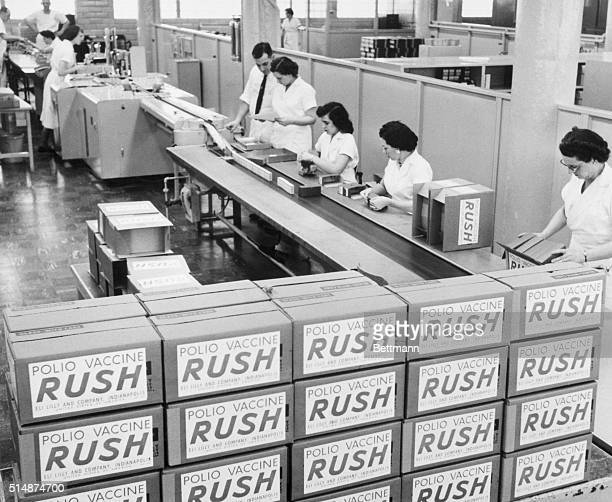 4/19/1956Indianapolis IN At the Eli Lilly and Company plant in the finishing department the bottles are labled put in to individual cartons wih...