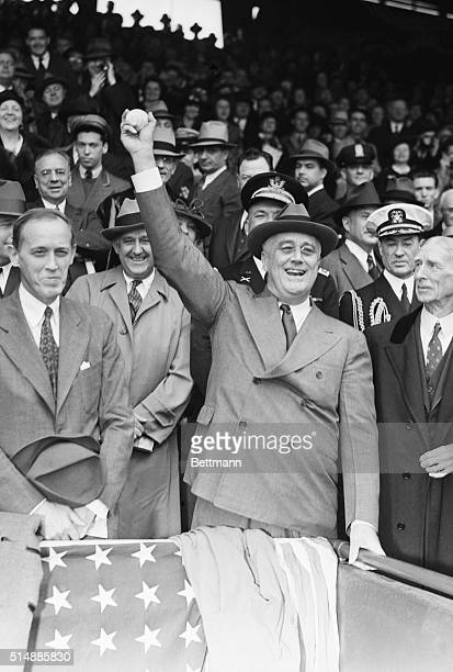 The Roosevelt smile was hitting on all six as the Chief Executive wound up here for the pitch that opened the 1938 baseball season at Griffith...