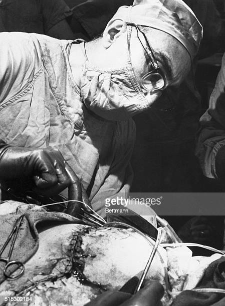 4/21/1966Houston Texas Heart surgeon Dr Michael DeBakey pulls final stitches to close the chest cavity of 65yearold Marcel DeRudder after a team of...