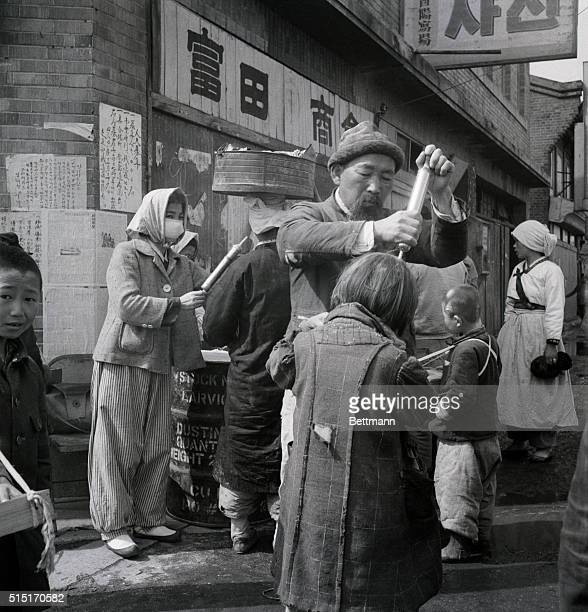 4/2/1951Seoul Korea Health officials spray DDT over the residents in an effort to cut down the spread of typhus UN forces who recently reoccupied the...