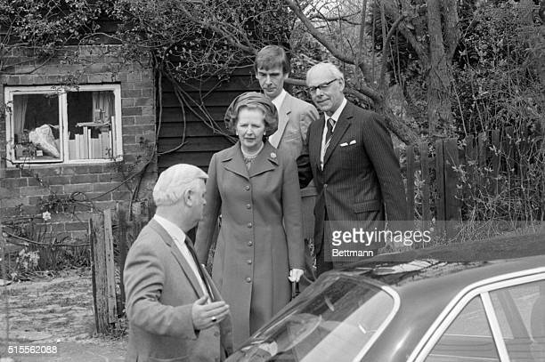 4/22/1984Chequers England Prime Minister Margaret Thatcher walks to her car escourted by husband Denis after Easter Sunday Church services in her...