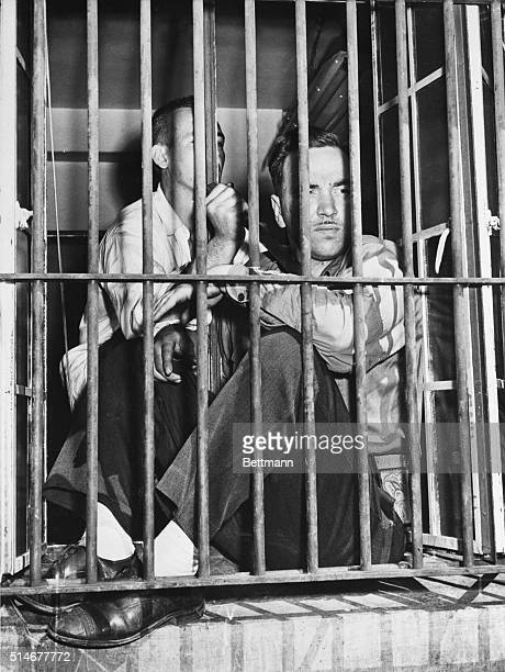 Guard Kenneth Parsons presents an extraordinary calm face to the world under the circumstances as he sits in a window of disciplinary cell block 15...