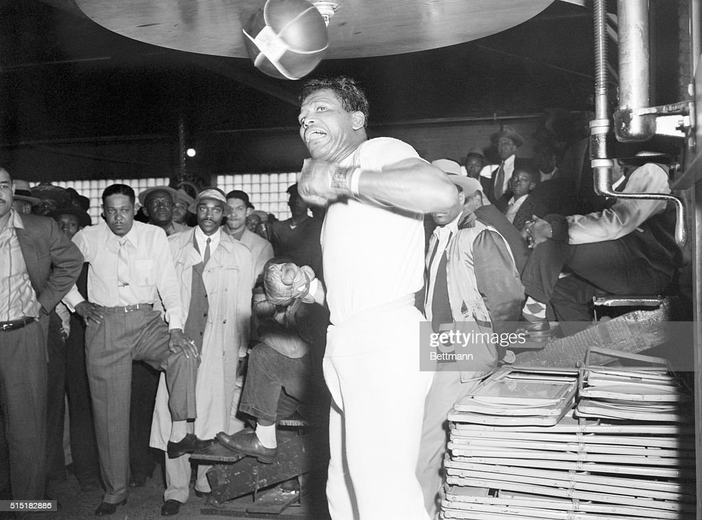 4/23/1957Chicago IL Former middleweight champion Sugar Ray Robinson punches the bag during a workout at Joe Louis' gymnasium Robinson will attempt to...