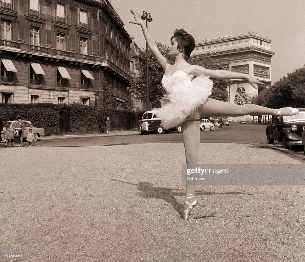 Paris, France- Paris' famed Arch of Triumph is reduced to background scenery as 16 1/2-year-old Colette Descombes strikes a gracefully-balanced pose. The teenager was studying for the ballet when she was chosen for the leading part in a new movie called 'Les Nymphettes' (The Little Nymphs), and she now seems headed for stardom.