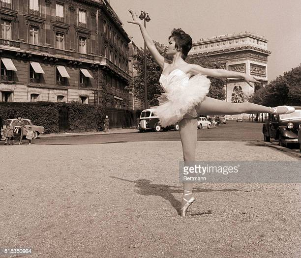 4/25/1960Paris France Paris' famed Arch of Triumph is reduced to background scenery as 16 1/2yearold Colette Descombes strikes a gracefullybalanced...