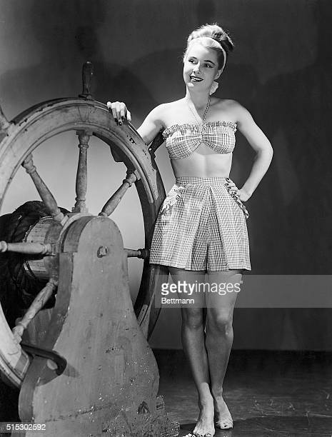 4/28/1946Checkered taffeta is used to make this twopiece number Shorts are panty style with a ruffle trim to match the halter bra Giving up those six...
