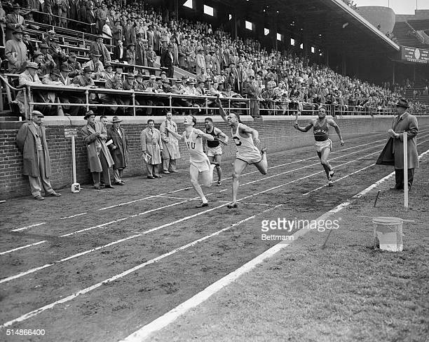 4/29/1950Philadelphia PA Ira Kaplan of New York University is shown breasting the tape as his school won the onehalf mile college relay championship...