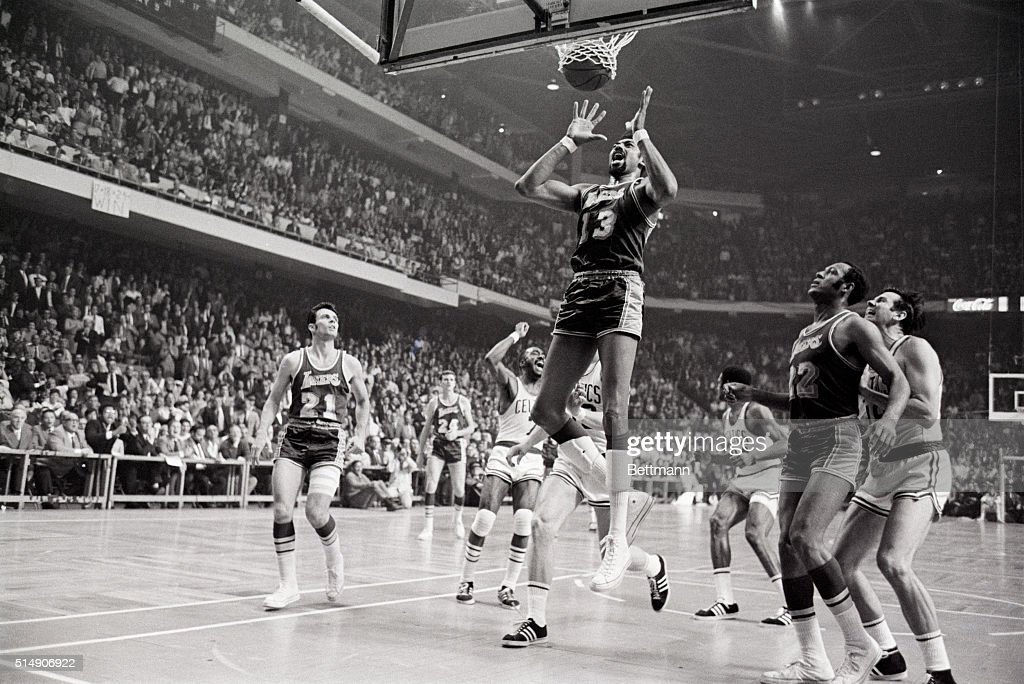 4/29/1969BostonMA LA Lakers' Wilt Chamberlain grimaces as Celtics' Sam Jones winning basket with one second left in game parts the twine 4th quarter...