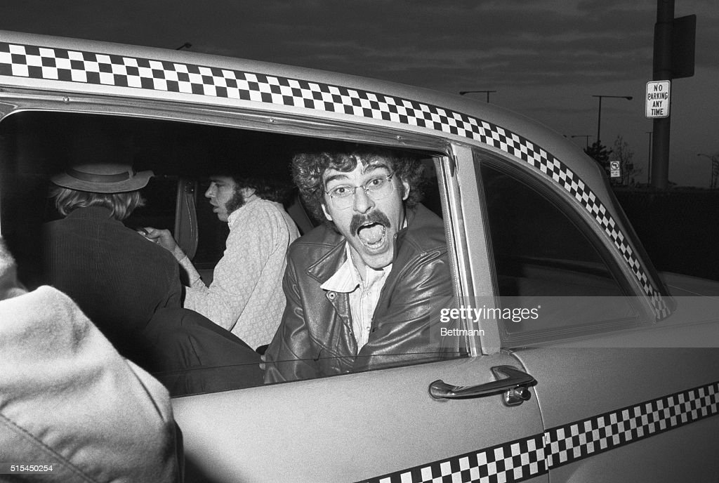 New York, NY- Knick's Phil Jackson prepares to enter a cab at LaGuardia Airport, after the team's return from Boston and a 94-78 win over the Celtics. The Knicks will meet the Los Angeles Lakers in the NBA championship series.