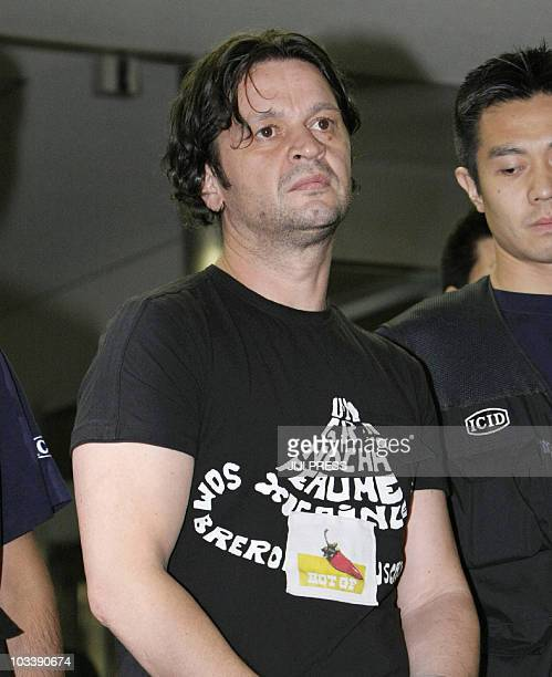 42yearold Montenegrin Rifat Hadziahmetovic an alleged member of the 'Pink Panther' gang of international jewel thieves arrives at the Narita...