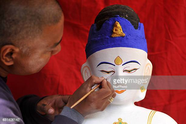 BAJRACHARYA 42yrs old a priest decorates the idol Seto Machhendranath at Jan Bahal Kathmandu Nepal on Tuesday January 2017 Seto Machhendranath is...