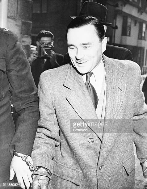 4/3/1949London England Inside the court building dapper John George Haigh stands trial for the slaying of wealthy widow Mrs Olive DurandDeacon...