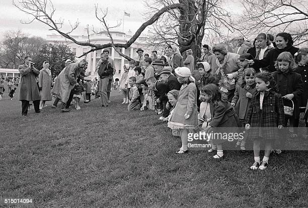 4/3/1961Washington DC Youngsters roll their eggs on the White House lawn today in the annual Easter Egg Roll despite the absence of the star...