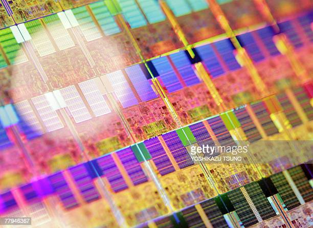 A 45nm process 300mm silicon wafer is displayed at a press conference as Intel Japan announces the launch of the new 45nm process microprocessors...