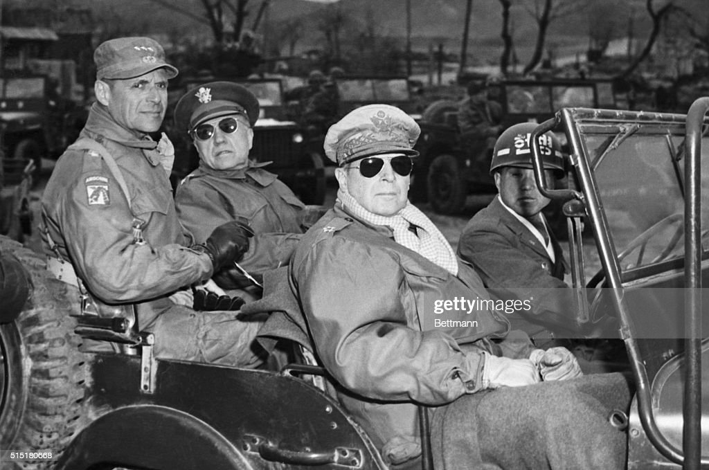 L to r: Lieutenant General Matthew B. Ridgeway, Coast Guard, US 8th Army, Major General Doyle O. Hickey, acting Chief of Staff, General Headquarters, FEC, and General Douglas MacArthur, Commander in Chief, UN Forces in Korea, are seen in a jeep at the Command Post in St. ROK Corps Area, Yang Yang, Korea, approximately 15 miles north of the 38th Parallel, during <a gi-track='captionPersonalityLinkClicked' href=/galleries/search?phrase=General+MacArthur&family=editorial&specificpeople=90932 ng-click='$event.stopPropagation()'>General MacArthur</a>'s most recent visit to the front. BPA