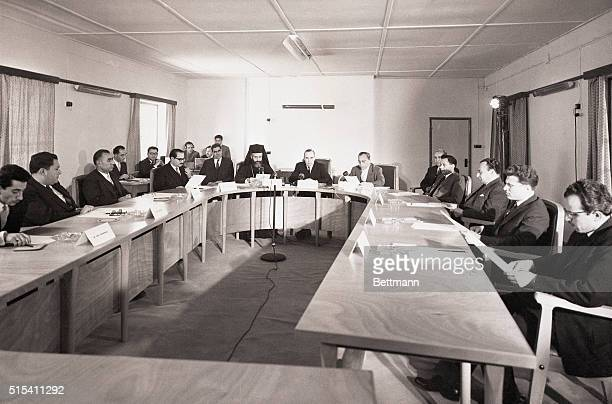 4/6/1959Nicosia Cyrpus Sir Hugh Foot the governor background opens the first meeting of the Cyprus Provisional Cabinet He sits between Archbishop...