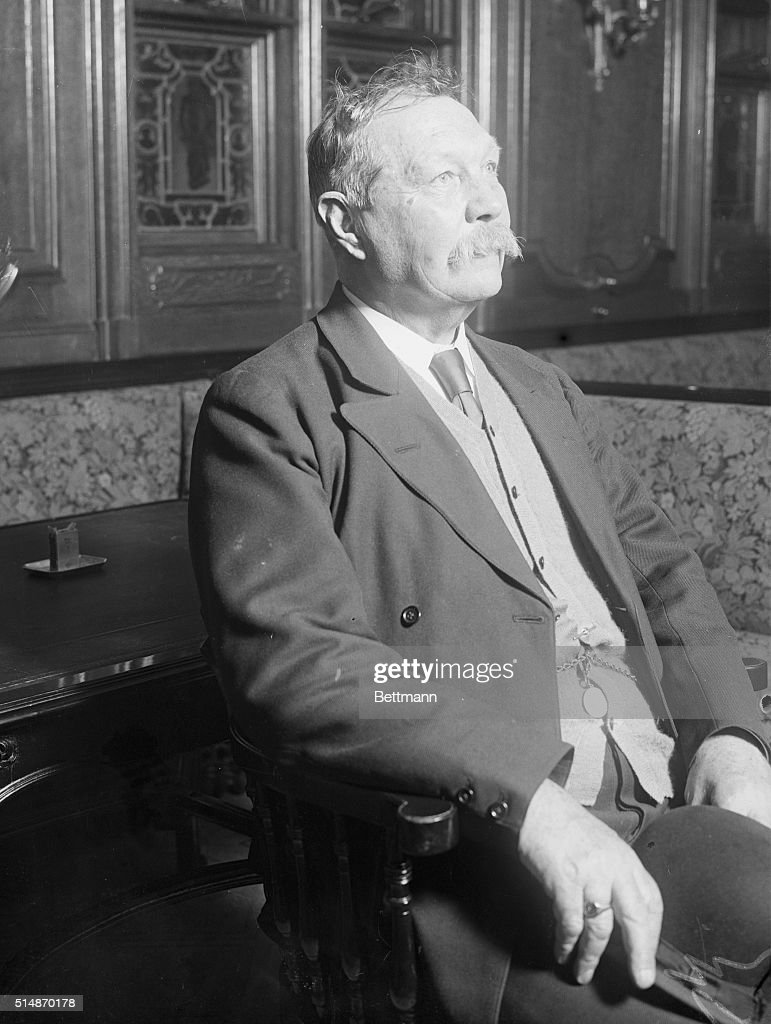 Close-up of Sir <a gi-track='captionPersonalityLinkClicked' href=/galleries/search?phrase=Arthur+Conan+Doyle&family=editorial&specificpeople=203200 ng-click='$event.stopPropagation()'>Arthur Conan Doyle</a> seated.