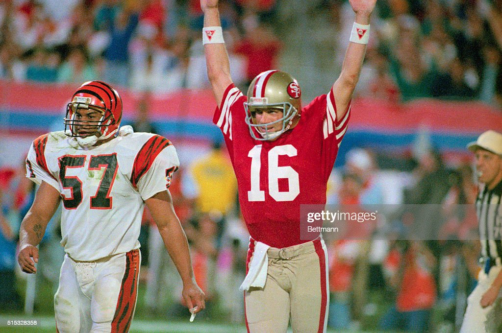 49ers quarterback <a gi-track='captionPersonalityLinkClicked' href=/galleries/search?phrase=Joe+Montana&family=editorial&specificpeople=206967 ng-click='$event.stopPropagation()'>Joe Montana</a> raises his arm in celebration after throwing a touchdown pass to Jerry Rice in the fourth quarter. Bengal Sam Kennedy looks on.