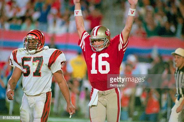49ers quarterback Joe Montana raises his arm in celebration after throwing a touchdown pass to Jerry Rice in the fourth quarter Bengal Sam Kennedy...