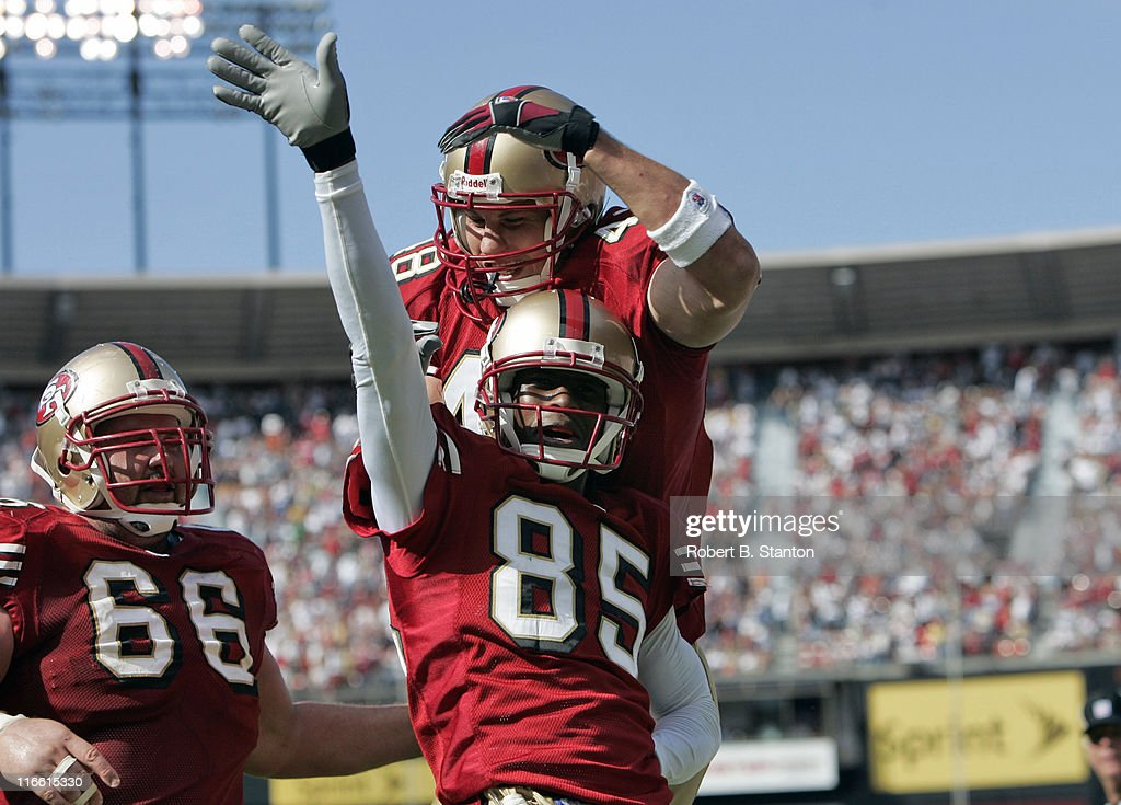 49ers wide receiver <a gi-track='captionPersonalityLinkClicked' href=/galleries/search?phrase=Brandon+Lloyd&family=editorial&specificpeople=206502 ng-click='$event.stopPropagation()'>Brandon Lloyd</a> celebrates after scoring a touchdown in the third quarter as the Dallas Cowboys defeated the San Francisco 49ers by a score of 34 to 31 at Monster Park, San Francisco, California, September 25, 2005.