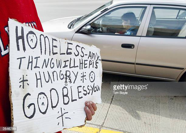 49yearold homeless person Darrell Chambers from North Platte Nebraska solicits donations along an expressway offramp September 29 2003 in Chicago...