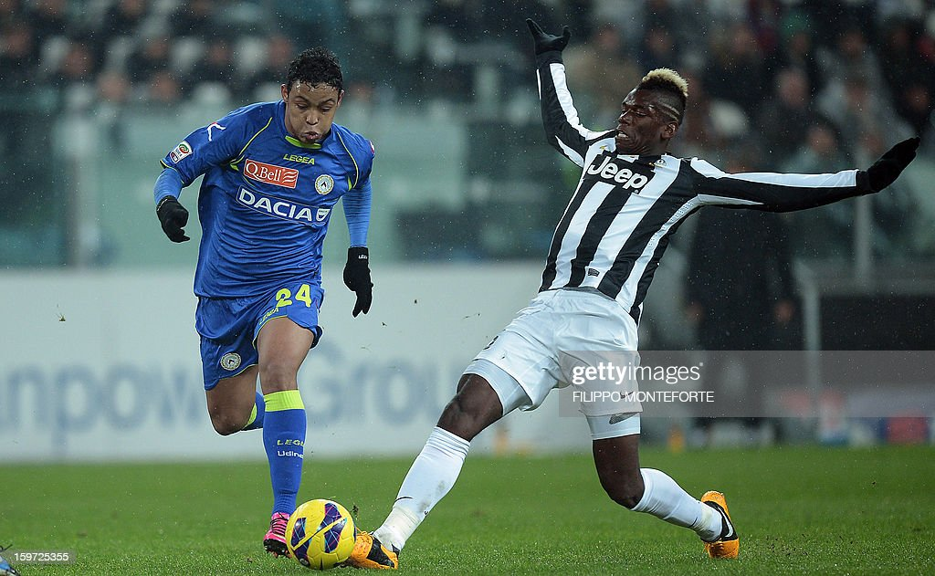 4Juventus' French midfielder Paul Pogba (R) vies with Udinese's defender of Colombia Muriel Fruto Luis Fernando during their Serie A football match in Turin's Juventus Stadium on January 19, 2013.