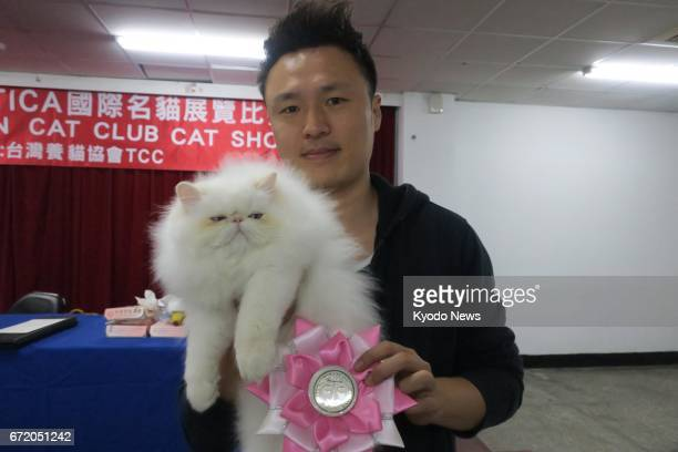 A 4monthold male Himalayan feline and his owner pose for Kyodo News after receiving unanimous vote on the best kitten at the eighth cat show...