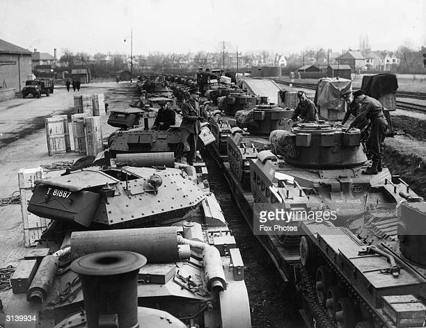 British Valentine and Matilda tanks being loaded onto a train bound for Russia
