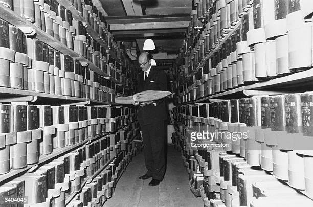 The Registrar General Michael Reed in the vaults of Somerset House London studies some of the thousands of public records before launching the first...