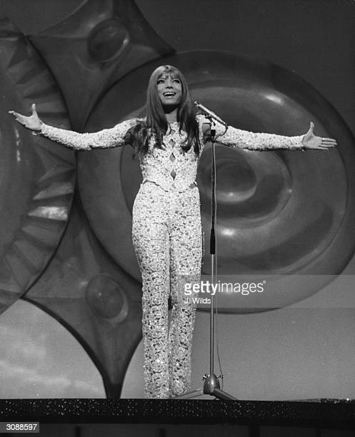 In a closefitting lace trouser suit Katja Ebstein singing in the Eurovision Song Contest at the Gaiety Theatre Dublin she came third