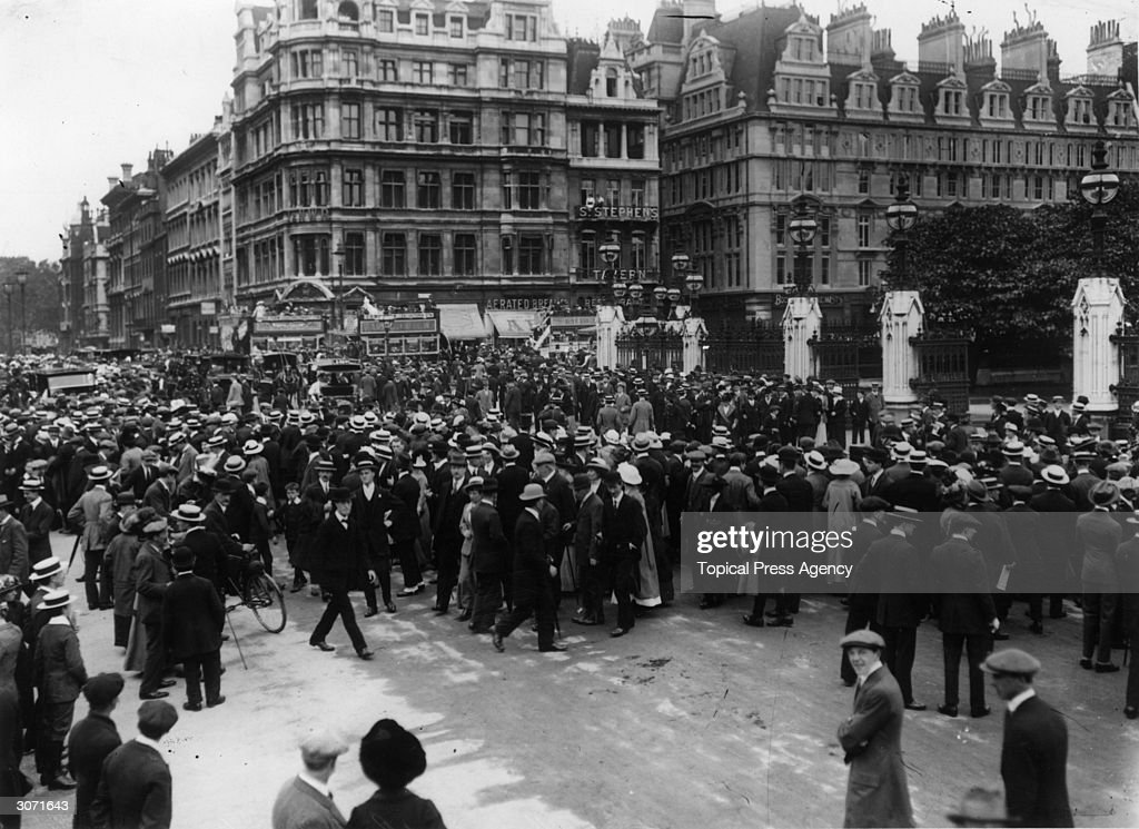 Crowds gather outside the House of Commons in London's Westminster, waiting for news on the day that Britain declared war on Germany.