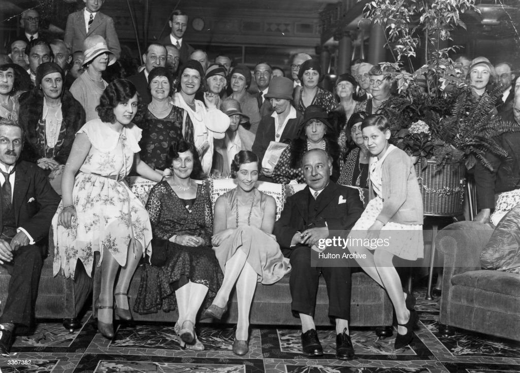 English aviator Amy Johnson (1903 - 1941), centre, with her family at the Grosvenor House hotel in London, after arriving back in Britain following her pioneering solo flight to Australia.
