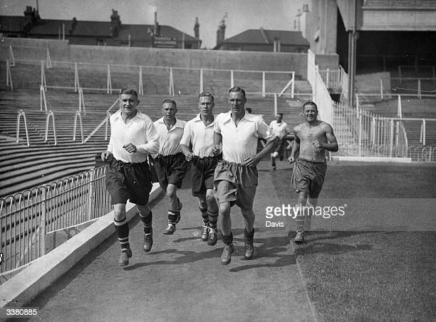 Arsenal Football Club players train at Highbury for the new season that will see them defending their League Championship title