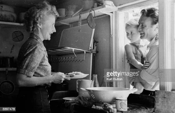 English actor John Mills his wife playwright Mary HayleyBell and their daughter Juliet at their cottage in Denham village England Original...